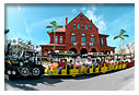 conch train driving by customs house in key west